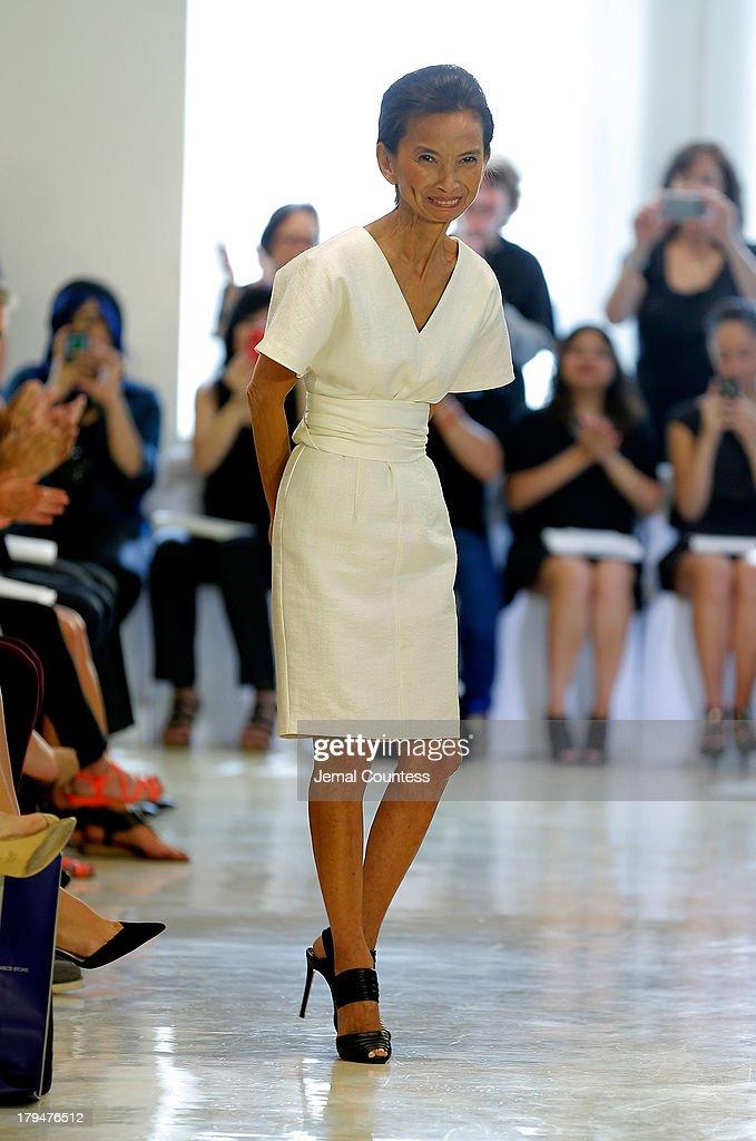 Designer Josie Natori takes a bow at the Josie Natori fashion show during Mercedes-Benz Fashion Week Spring 2014 on September 4, 2013 in New York City.