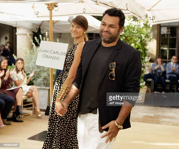 Designer Juan Carlos Obando walks the runway during the 2013 CFDA/Vogue Fashion Fund Event Presented by thecornercom and Supported by Audi Living...