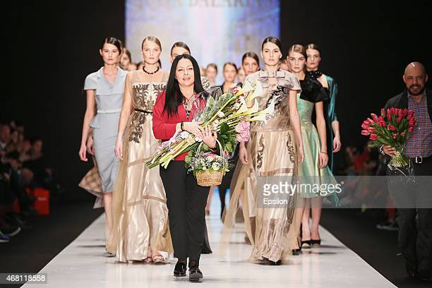 Designer Julia Dalakian walks the runway after her show during day 4 of Mercedes Benz Fashion Week Russia Autumn/Winter 2015/16 at Manege on March 29...
