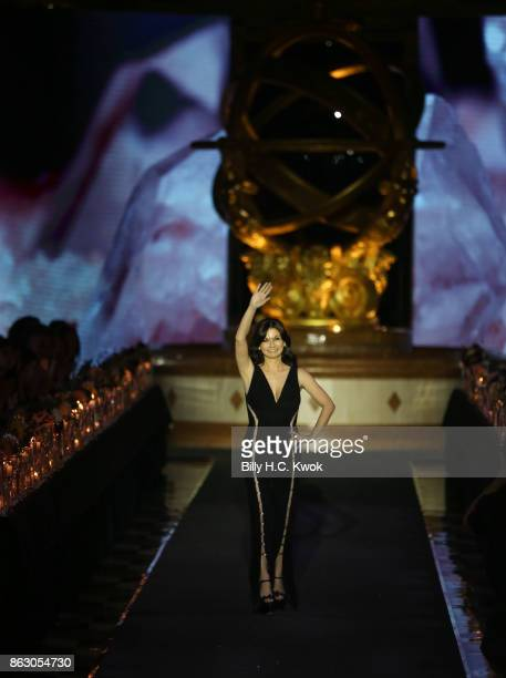 Designer Julia Haart appears at the end of the runway show during La Perla Spring/Summer 2018 Collection at The Sands Macao Fashion Week on October...