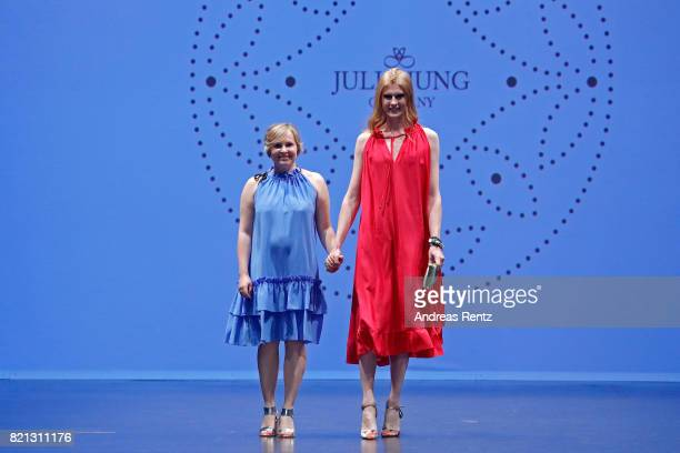 Designer Julia Jung acknowledges the applause of the audience after her show together with model Veit Alex at the Fashionyard show during Platform...