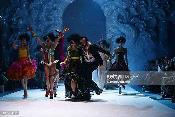 Designer Julien Fournie reacts on the runway at the end of his show on day 1 of French Couture Week 2012 Singapore at The Shoppes at Marina Bay Sands...