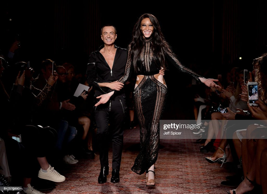 Designer Julien Macdonald and model Winnie Harlow walk the runway at the Julien Macdonald show during the London Fashion Week February 2017 collections on February 18, 2017 in London, England.