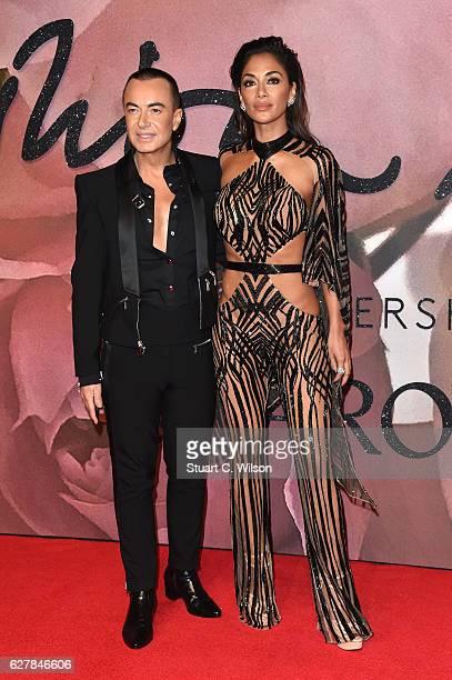 Designer Julien Macdonald and singer Nicole Scherzinger attend The Fashion Awards 2016 on December 5 2016 in London United Kingdom
