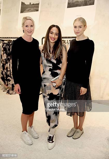 Designer Juliette Hogan actresses Cleopatra Coleman and Penelope Mitchell wearing a Juliette Hogan design attend the Juliette Hogan SS16 showcase at...