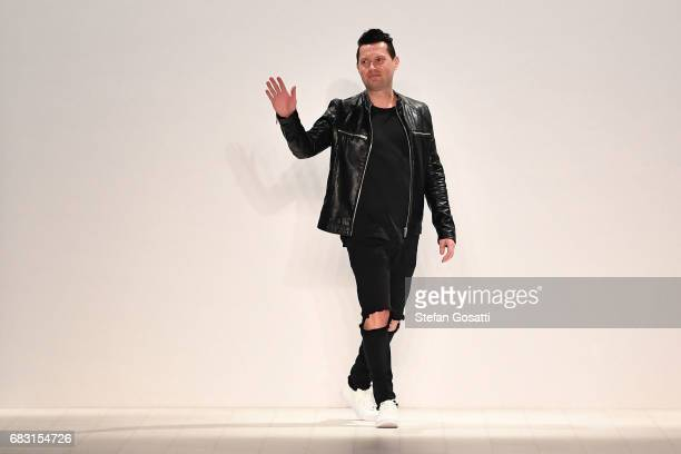 Designer Justin Cassin thanks the audience following the Justin Cassin show at MercedesBenz Fashion Week Resort 18 Collections at Carriageworks on...