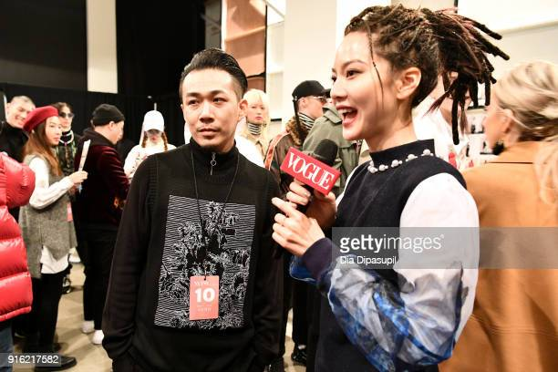 Designer Justin YuYing Chou is interviewed backstage by Tseng ChihChiao for the Just In XX Presentation at Gallery II at Spring Studios on February 9...