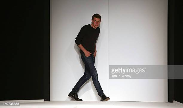 Designer JW Anderson appears on the runway at the JW Anderson show during the London Collections MEN SS14 at The Old Sorting Office on June 17 2013...