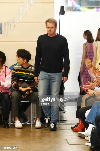 Designer JW Anderson walks the runway at the JW Anderson show during Paris Men's Fashion Week Spring/Summer 2020 on June 19 2019 in Paris France