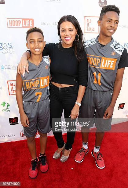 Designer Kai Milla and sons Mandla Morris and Kailand Morris attend the 4th Annual Kailand Obasi HoopLife Fundraiser at USC Galen Center on August 28...