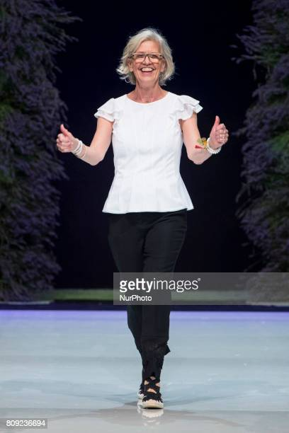 Designer Karin Veit acknowledges the applause of the guests at the end of Marc Cain Spring/Summer 2018 fashion show at EWerk in Berlin Germany on...