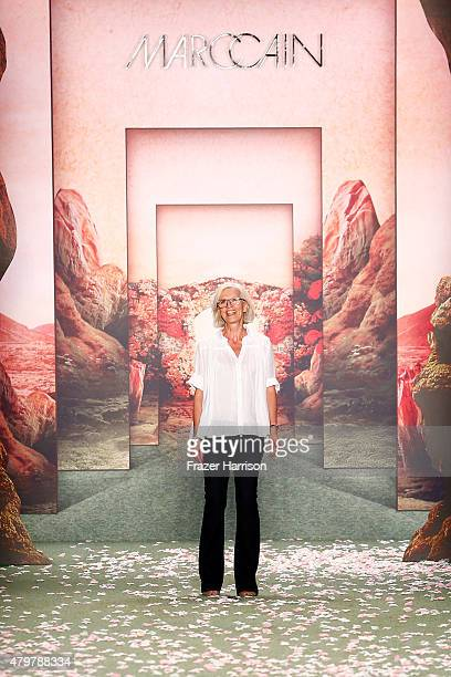 Designer Karin Veit isseen on the runway at the Marc Cain show during the MercedesBenz Fashion Week Berlin Spring/Summer 2016 at Brandenburg Gate on...