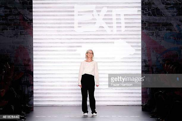 Designer Karin Veit walks the runway at the Marc Cain show during the MercedesBenz Fashion Week Berlin Autumn/Winter 2015/16 at Brandenburg Gate on...