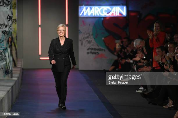 Designer Karin Veit walks the runway during the Marc Cain Fashion Show Berlin Autumn/Winter 2018 at metro station Potsdamer Platz on January 16 2018...