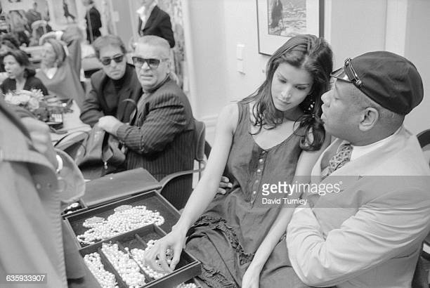 Designer Karl Lagerfeld a fashion model and André Leon Talley hang out backstage at a fashion show