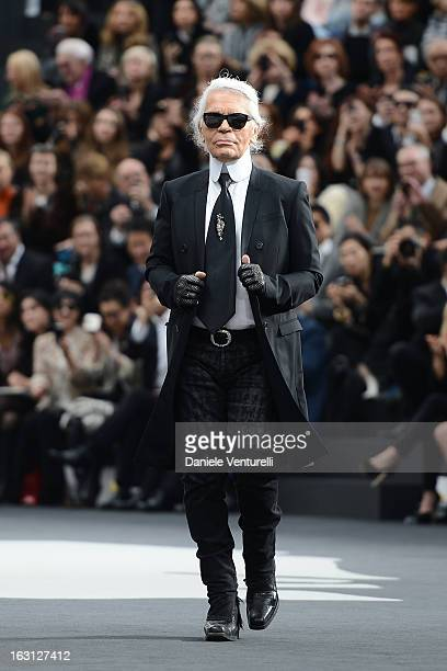 Designer Karl Lagerfeld acknowledges applause following the Chanel Fall/Winter 2013 ReadytoWear show as part of Paris Fashion Week at Grand Palais on...