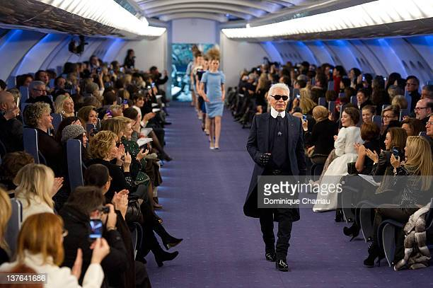 Designer Karl Lagerfeld acknowledges the applause of the audience after the Chanel HauteCouture Spring / Summer 2012 Show as part of Paris Fashion...