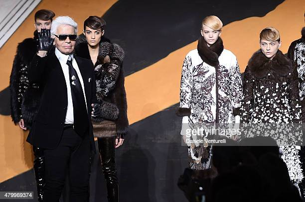 Designer Karl Lagerfeld aknowledge the applause of the public after the Fendi show as part of Paris Fashion Week Haute Couture Fall/Winter 2015/2016>...