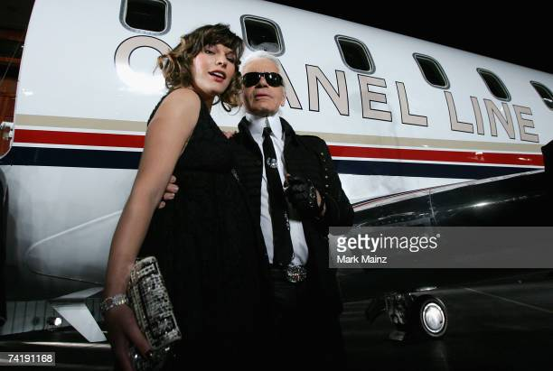 Designer Karl Lagerfeld and actress Milla Jovovich attend the 2007/8 Chanel Cruise Show Presented By Karl Lagerfeld held at Hangar 8 on May 18 2007...
