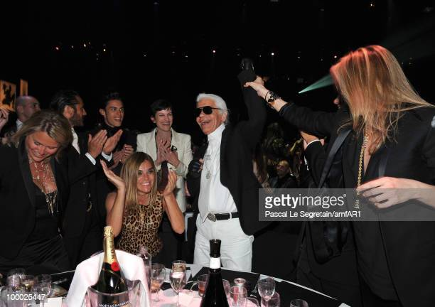 Designer Karl Lagerfeld and Editorinchief of French Vogue Carine Roitfeld attend amfAR's Cinema Against AIDS 2010 benefit gala dinner at the Hotel du...