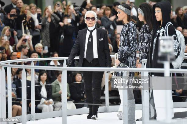 Designer Karl Lagerfeld and his godson Hudson Kroenig are seen on the runway during the finale of the Chanel show as part of the Paris Fashion Week...