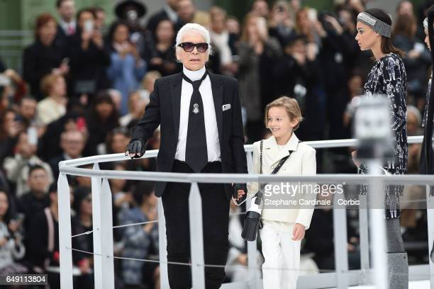 Designer Karl Lagerfeld and his godson Hudson Kroenig are seen on the runway during the Chanel show as part of the Paris Fashion Week Womenswear...