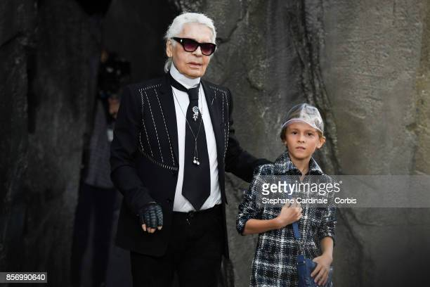 Designer Karl Lagerfeld and Hudson Kroenig walk the runway during the Chanel Spring Summer 2018 show as part of Paris Fashion Week at on October 3...