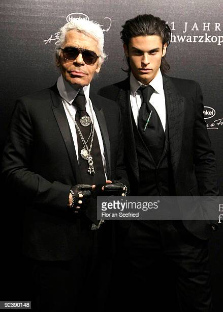 Designer Karl Lagerfeld and model Baptiste Giabiconi attend the 'We Love Hair 111 Years Schwarzkopf' celebration at NRW Forum on October 27 2009 in...