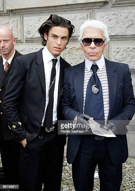 Designer Karl Lagerfeld and model Baptiste Giabiconi leave the Hotel de Rome on July 23 2009 in Berlin Germany