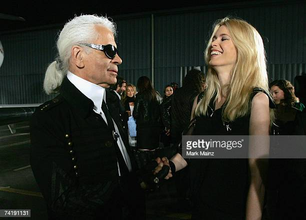 Designer Karl Lagerfeld and model Claudia Schiffer attend the 2007/8 Chanel Cruise Show Presented By Karl Lagerfeld held at Hangar 8 on May 18 2007...
