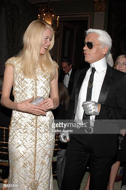 Designer Karl Lagerfeld and model Claudia Schiffer attend the Marie Clare Awards French Embassy November 22 2006 in Madrid Spain