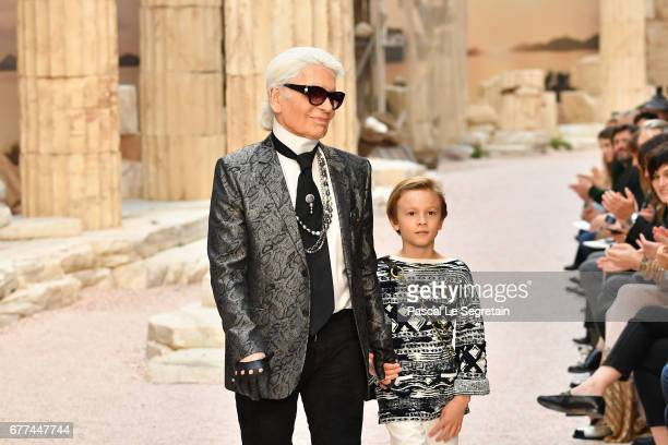 Designer Karl Lagerfeld and nephew Hudson Kroenig walk the runway during Chanel Cruise 2017/2018 Collection at Grand Palais on May 3, 2017 in Paris,...