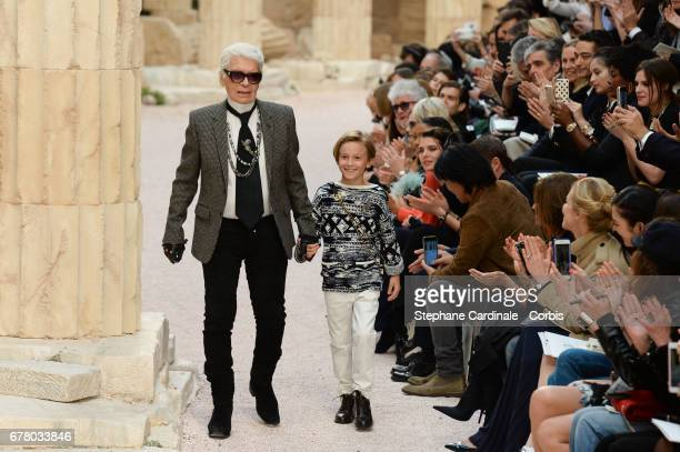 Designer Karl Lagerfeld and nephew Hudson Kroenig walk the runway during the Chanel Cruise 2017/2018 Collection at Grand Palais on May 3, 2017 in...