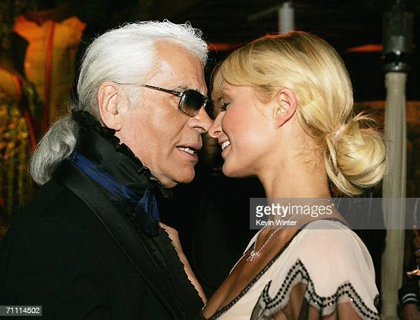 Designer Karl Lagerfeld and Paris Hilton pose at the International Launch of Dom Perignon Rose Vintage 1996 Champagne by Karl Lagerfeld on June 2...