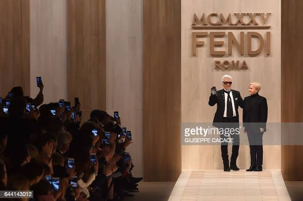 Designer Karl Lagerfeld and Silvia Venturini Fendi greet the audience at the end of the show for fashion house Fendi during the Women's Fall/Winter...