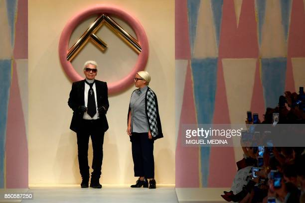 Designer Karl Lagerfeld and Silvia Venturini Fendi greet the audience at the end of the show for fashion house Fendi during the Women's Spring/Summer...