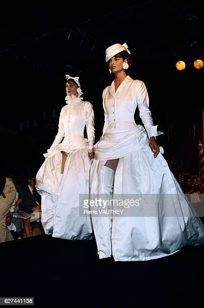 Designer Karl Lagerfeld displays his women's haute couture line for Chanel at the 19901991 AutumnWinter fashion show in Paris Models Linda...