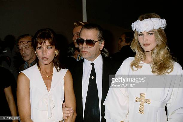 Designer Karl Lagerfeld displays his women's haute couture line for Chanel at the 19901991 AutumnWinter fashion show in Paris He is standing with...