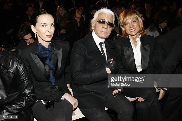 Designer Karl Lagerfeld model L'Wren Scott and Helene Arnaud attend the Dior men's show during Paris Men's Fashion Week Autumn/Winter 20062007 on...