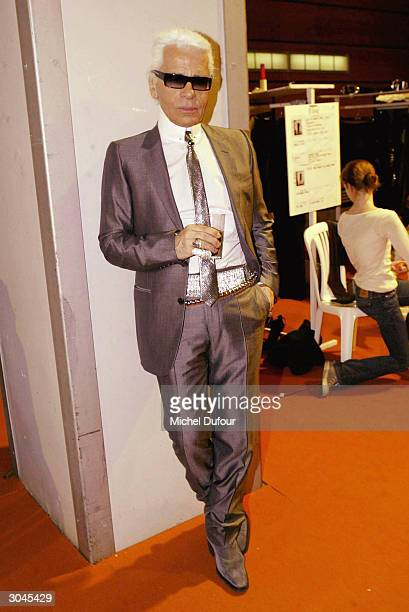 Designer Karl Lagerfeld poses backstage, at the Lagerfeld Gallery Ready-To-Wear Fall-Winter 2004-2005 fashion collection March 4, 2004 in Paris,...