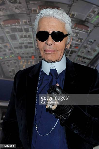 Designer Karl Lagerfeld poses for photogrpahs during the Chanel 2012 Spring/Summer Haute Couture Collection Show at Shinjuku Gyoen Park on March 22...