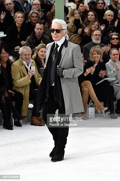 Designer Karl Lagerfeld salutes the public after the Chanel show as part of Paris Fashion Week Haute Couture Spring/Summer 2015 on January 27 2015 in...