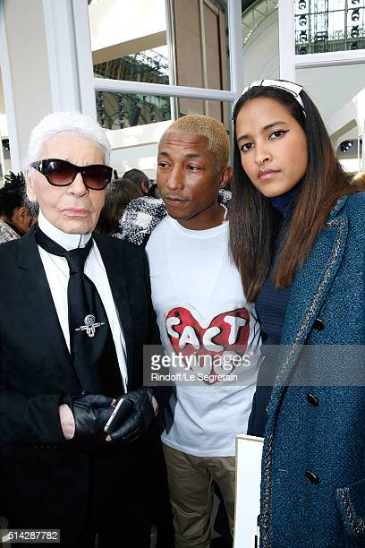 Designer Karl Lagerfeld Singer Pharrell Williams and his wife Helen Lasichanh attend the Chanel show as part of the Paris Fashion Week Womenswear...