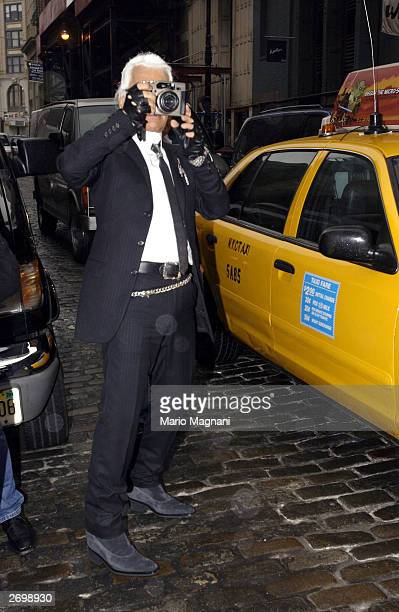 Designer Karl Lagerfeld takes a picture in Soho for his men's clothing line November 4 2003 in New York City