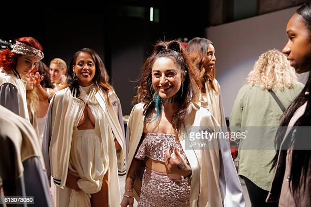 Designer Katharine Polk celebrates with models and friends backstage at the Houghton Bridal Show at ArtBeam on October 6 2016 in New York City