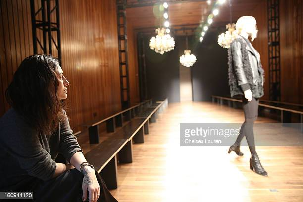 Designer Katharine Polk watches models rehearse at the Houghton fall 2013 fashion show during MercedesBenz Fashion Week at The Standard Hotel High...