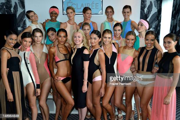 Designer Kelly Carrington poses with models at the Éclairée Presentation during Mercedes-Benz Fashion Week Swim 2013 at The Raleigh on July 20, 2012...