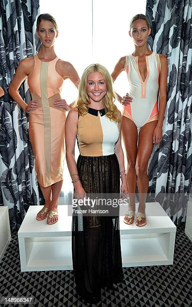 Designer Kelly Carrington poses with models at the Éclairée Presentation during MercedesBenz Fashion Week Swim 2013 at The Raleigh on July 20 2012 in...