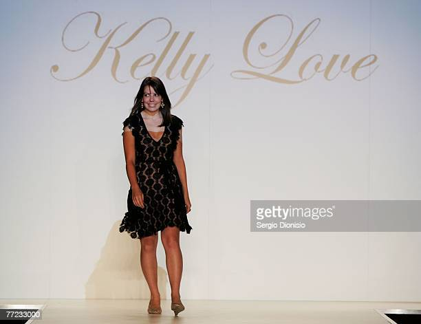 Designer Kelly Love of the label Kelly Love acknowledges the audience following her catwalk collection show as part of the New Generation Catwalk...
