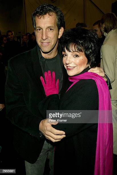 Designer Kenneth Cole and actress Liza Minnelli mingle backstage at the Kenneth Cole fashion show during Olympus Fashion Week at Bryant Park February...